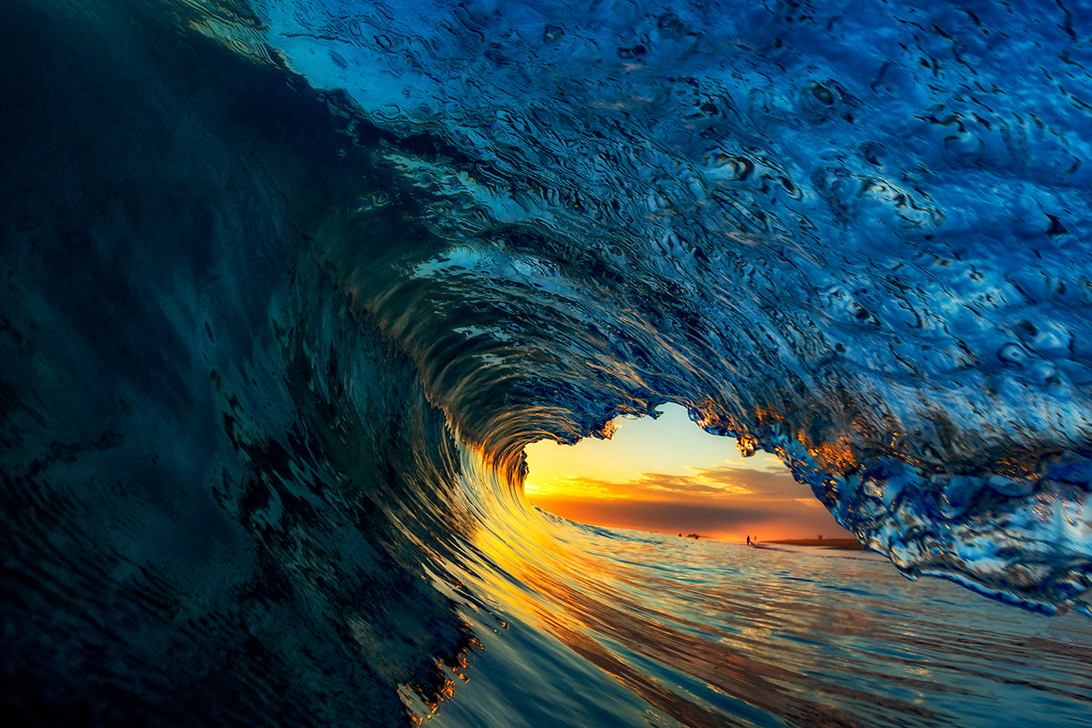 photo of curling wave at sunset by San Moniz