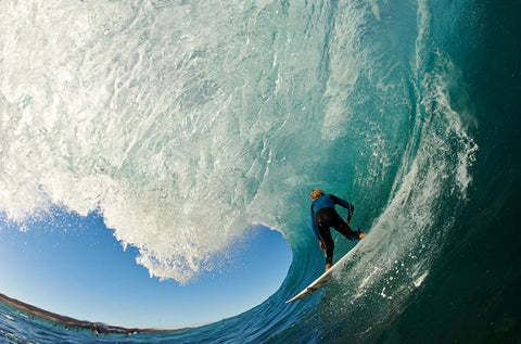 Surfer in a barrel