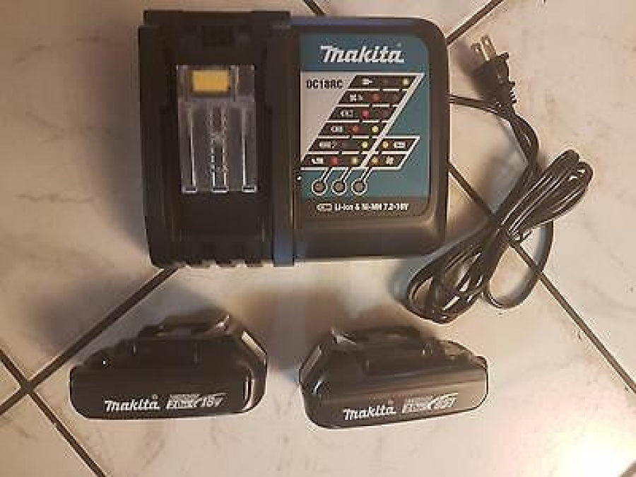 Makita 18 Volt (2) 2.0 MAh Batteries BL1820 & 7.2V - 18V Li Ion Charger DC18RC