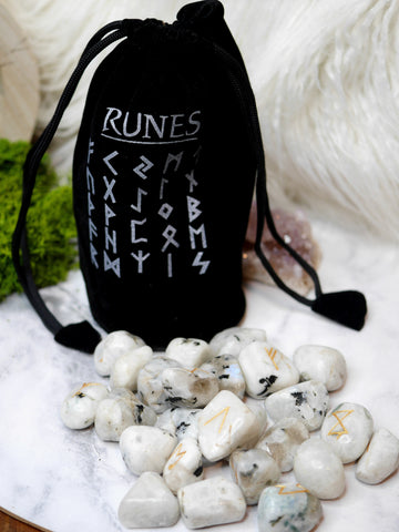 Crystal runes.  moonstone, bloodstone, rose quartz or tiger eye.