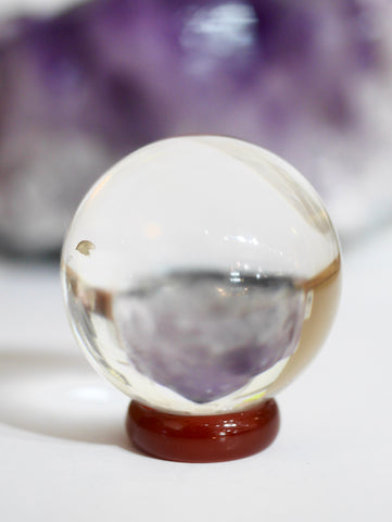 Quartz crystal ball with carnelian ring stand