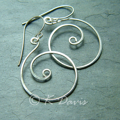 coiled silver earrings