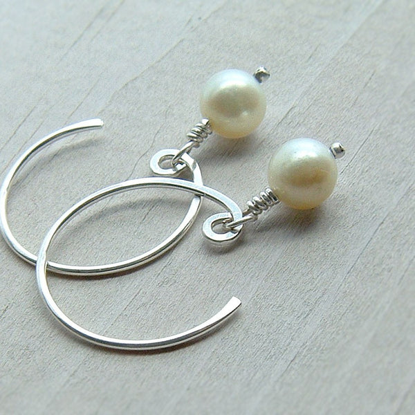 open hoop earring with pearl