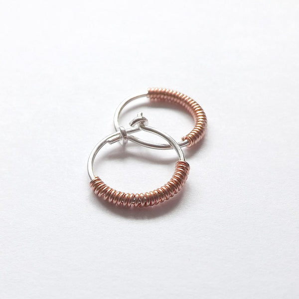 silver hoop wrapped with copper