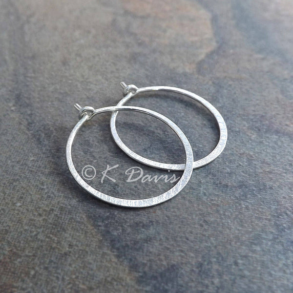 silver hoop earrings in a medium size