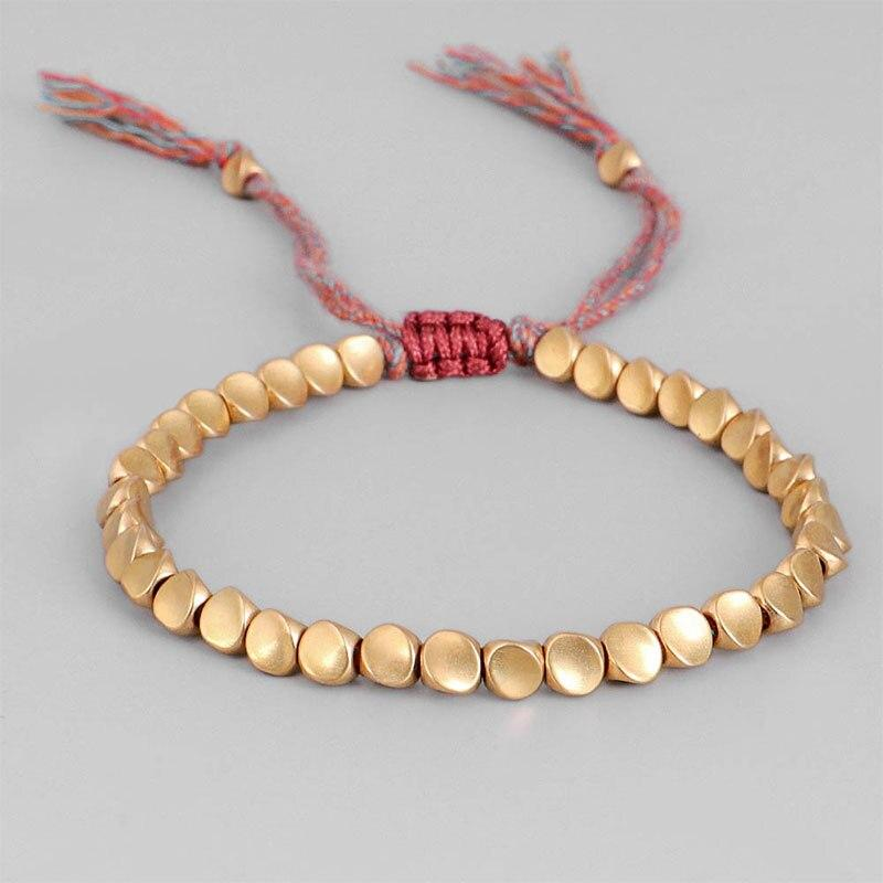 Hand-woven Tibetan bracelet with Tibetan copper beads Tibetan Braided Bracelets Artisan of Asia