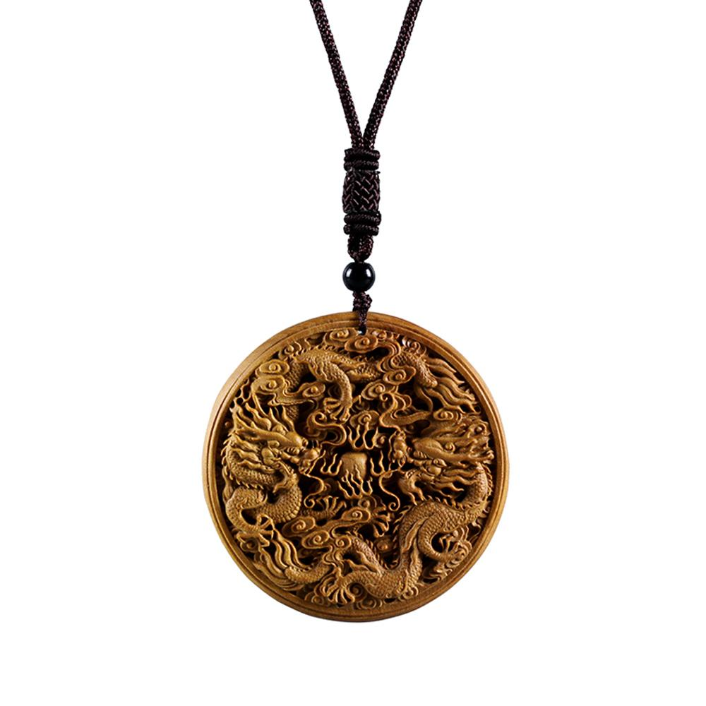 Feng Shui Dragon pendant in Santal Wood pendants - Asian Artisan Amulets