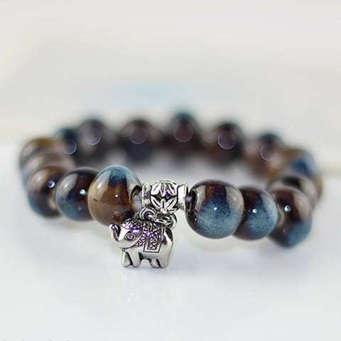 Two-Toned Blue and Brown Ceramic Elephant Charm Bracelet