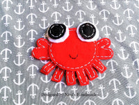 Nautical octopus sailor includes both applique and stitched