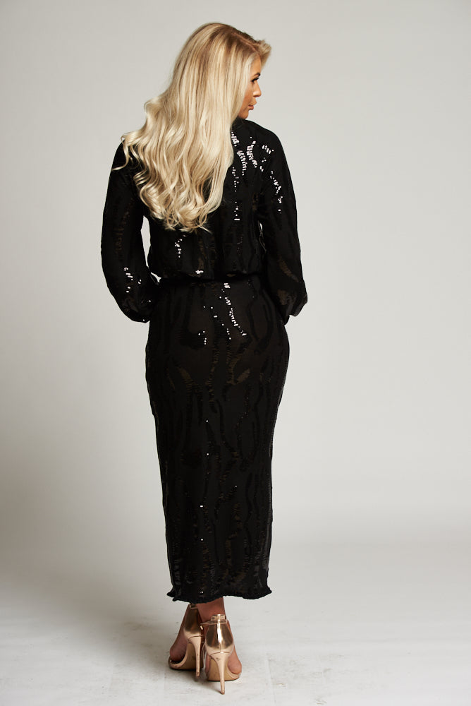 A Black Sequin and Jersey Long Sleeved Midi Dress with Ruched Detail