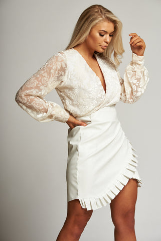A Winter White Lace Long Sleeve Bodysuit
