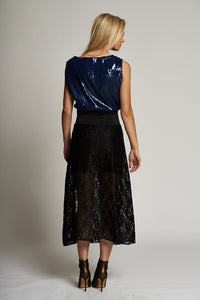 A Navy Sequin Sleeveless Top with Black Waistband Trim