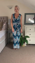 Load and play video in Gallery viewer, Sleeveless Maxi Wrap Summer Dress in Blue and White Aztec Print