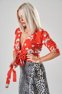 Red Floral Wrap Blouse with Ruched Sleeves and Frill Hem