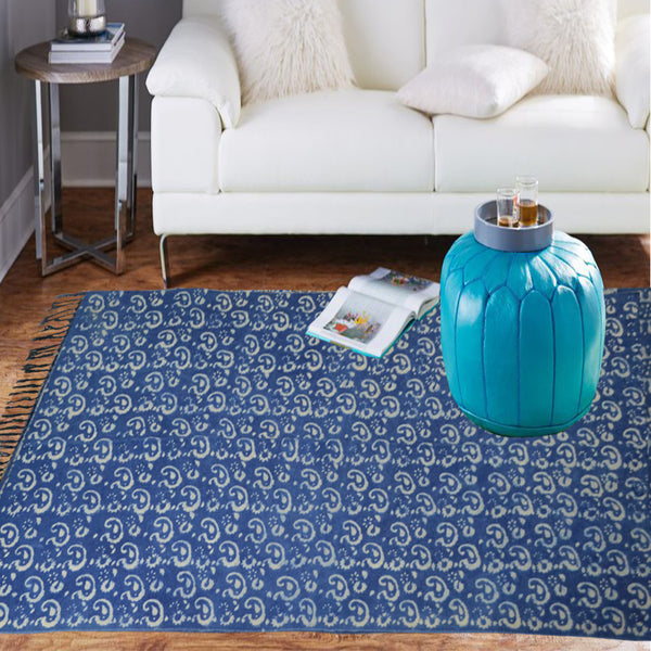 White indigo madness on a blue cotton rug