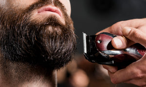 Woman-shaving-man-with-shaver