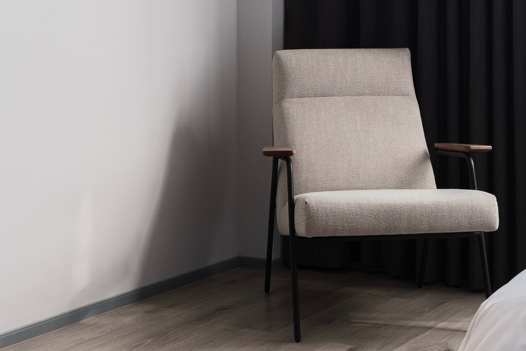 A therapist's chair in the corner of the room.