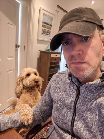 Writer Andrew Dickens and his dog Brewster.
