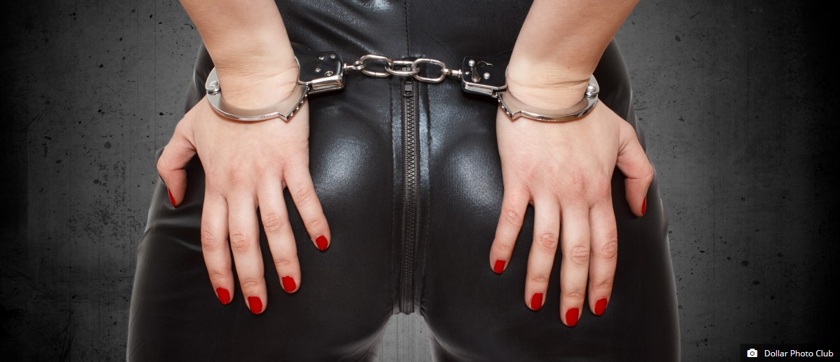 woman in cuffs and leather outfit