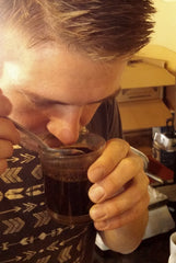 smelling and cupping coffee