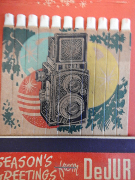 DeJur Amsco Camera Co. 1930's Christmas advertising camera big matchpack snowman