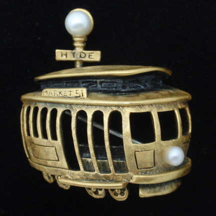 Planes, Trains, and Automobiles: Transportation Motifs in Costume Jewelry