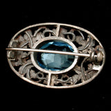 Faceted Blue Rhinestone Pin Silver Tone Open Work Floral Vintage Oval