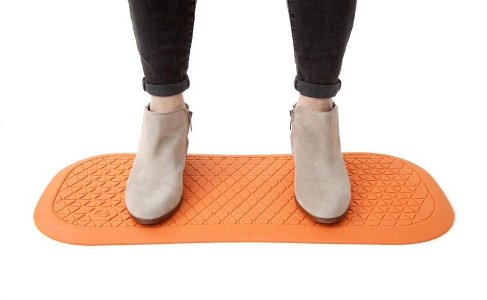 The UPmat™ - Dual-purpose foam standing desk mat  Feel good throughout the workday with the dual-function UPmat™, the standing desk mat that gives you the flexibility to work in comfort both on and off your FluidStance deck.
