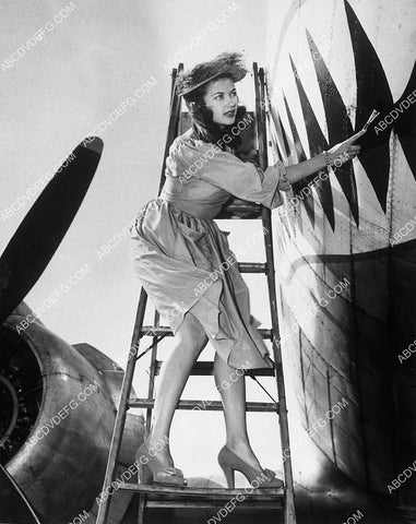 Yvonne De Carlo helps the war effort painting shark mouth on WWII airplane 10771-29