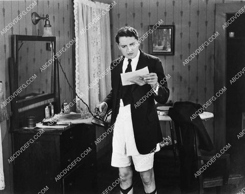 Bryant Washburn ironing his pants in his garters silent film Burglar Proof 1332-27