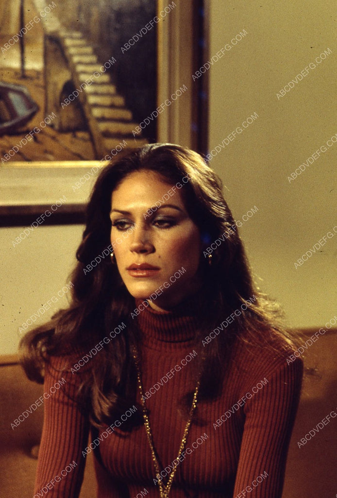 Pamela Hensley sitting on the couch 35m-5147