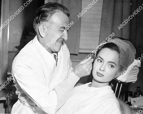 Ann Blyth sitting in Jack Pierce's makeup chair getting the works 5623a-12