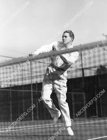 athletic Nelson Eddy on the tennis court 8B11-759