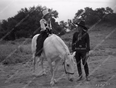 Buck Jones and cute cowgirl unknown film 8b03-360