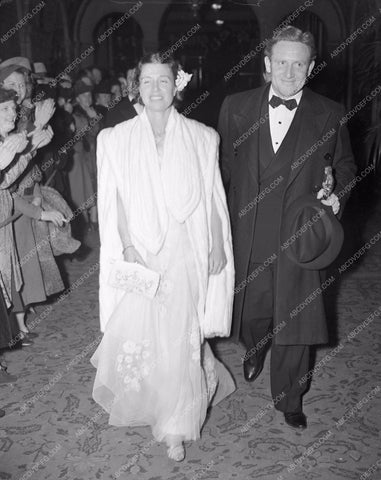 1938 Oscars Spencer Tracy and wife ? Arriving at the ceremonies aa1938-08</br>Los Angeles Newspaper press pit reprints from original 4x5 negatives for Academy Awards.