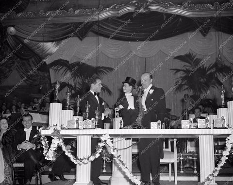 1938 Oscars Edgar Bergen Charlie McCarthy Frank Capra on stage aa1938-09</br>Los Angeles Newspaper press pit reprints from original 4x5 negatives for Academy Awards.