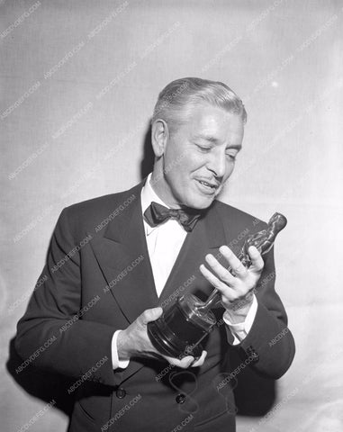1947 Oscars Ronald Colman admiring his statue Academy Awards aa1947-26</br>Los Angeles Newspaper press pit reprints from original 4x5 negatives for Academy Awards.
