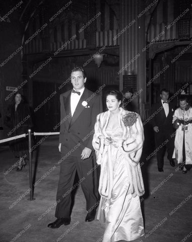 1949 Oscars Rock Hudson Yvonne De Carlo arriving at Academy Awards aa1949-98</br>Los Angeles Newspaper press pit reprints from original 4x5 negatives for Academy Awards.
