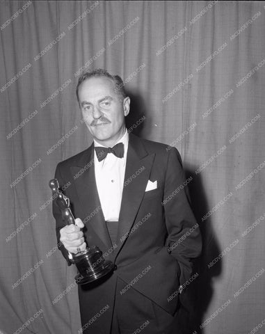 1954 Oscars Darryl F. Zanuck and statue Academy Awards aa1954-16</br>Los Angeles Newspaper press pit reprints from original 4x5 negatives for Academy Awards.