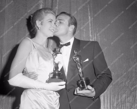 1954 Oscars Grace Kelly Marlon Brando congrat kiss Academy Awards aa1954-50</br>Los Angeles Newspaper press pit reprints from original 4x5 negatives for Academy Awards.