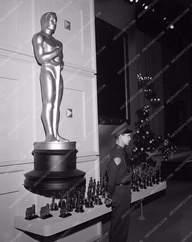 1955 Oscars guard watching over coveted statues Academy Awards aa1955-34</br>Los Angeles Newspaper press pit reprints from original 4x5 negatives for Academy Awards.