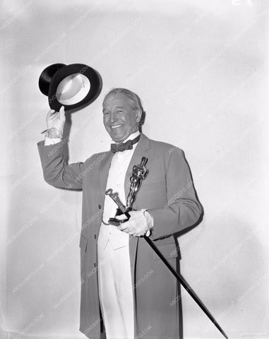 1958 Oscars Maurice Chevalier and statue Academy Awards aa1958-60</br>Los Angeles Newspaper press pit reprints from original 4x5 negatives for Academy Awards.
