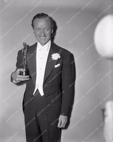 1958 Oscars David Niven and his statue Academy Awards aa1958-61</br>Los Angeles Newspaper press pit reprints from original 4x5 negatives for Academy Awards.