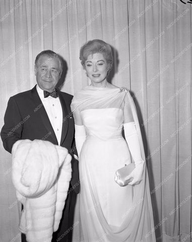 1960 Oscars Greer Garson and husband maybe Academy Awards aa1960-102</br>Los Angeles Newspaper press pit reprints from original 4x5 negatives for Academy Awards.