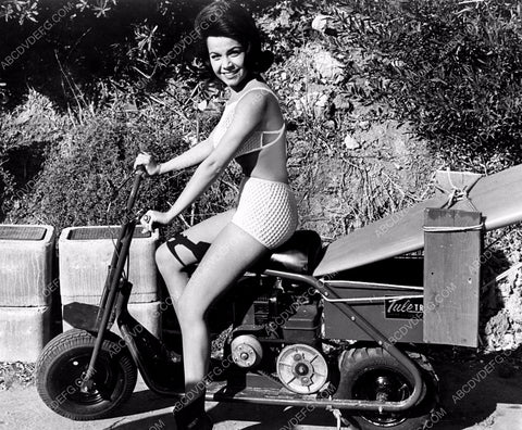 Annette Funicello tows her surfboard on cool motor scooter 8b20-2894