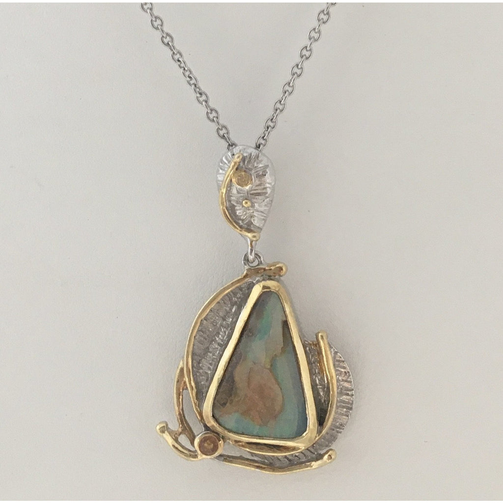 One-of-a-kind sterling and gold Opal pendant with sapphire