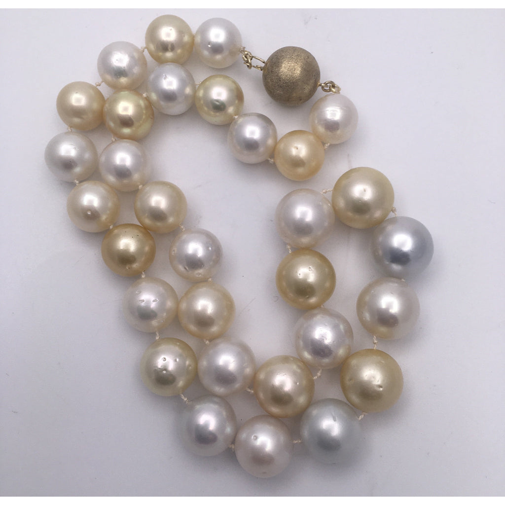 Lustrous golden, white and soft silver South Sea pearls