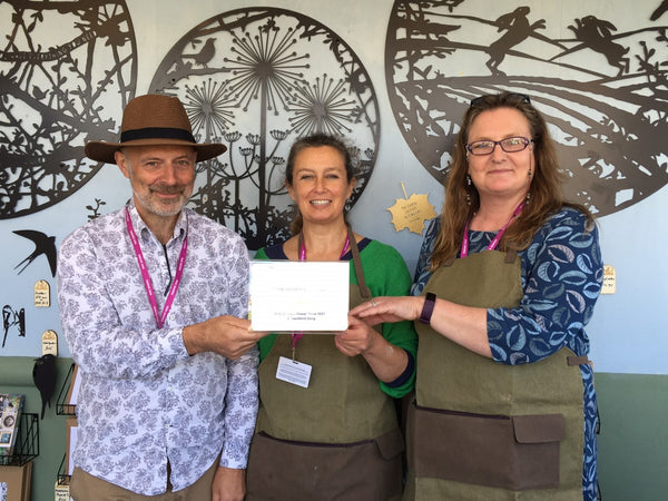 Image of Tony, Genny and Jane holding a certificate on the A Blackbird Sang stand at RHS Chelsea Flower Show 2021