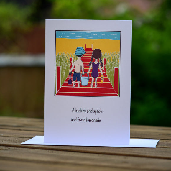 Greetings card - 'A bucket and spade and fresh lemonade.'