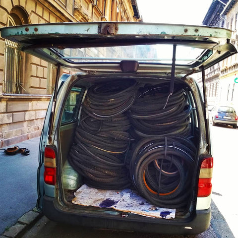 Taking used bicycle tyres and tubes for recycling